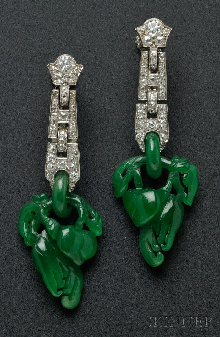 Art Deco Platinum, Jadeite, and Diamond Earpendants, Cartier, each designed as interlocking links bead-set with old European and old mine-cut diamonds suspending a jadeite ring and carved leafy vine with gourds, no. 3419362, signed.