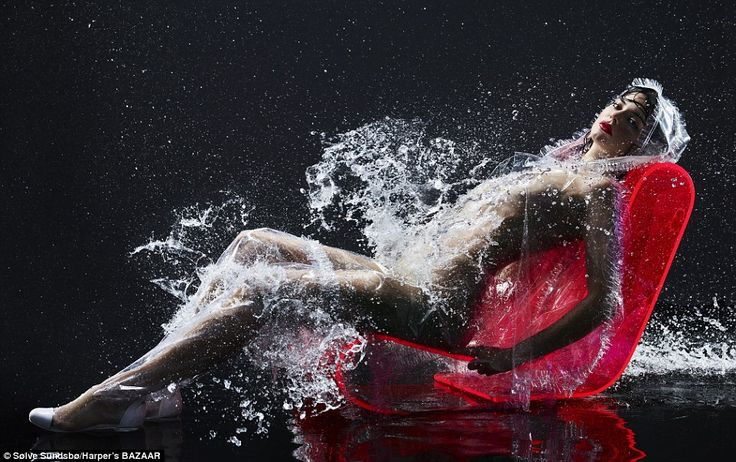 Making a splash! Kendall Jennercould be seen going completely nude under a clear Chanel cape with matching boots from the same designer in a photoshoot for Harper's Bazaar released on Thursday