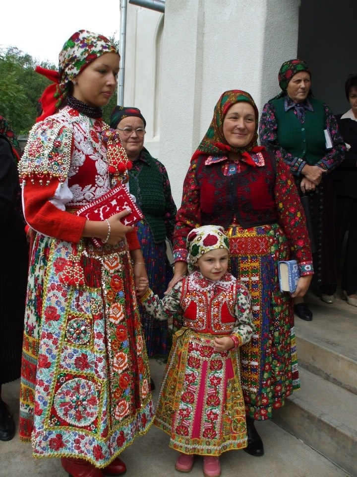 Hungary. Three generations showing their wonderful costumes! (lbk)