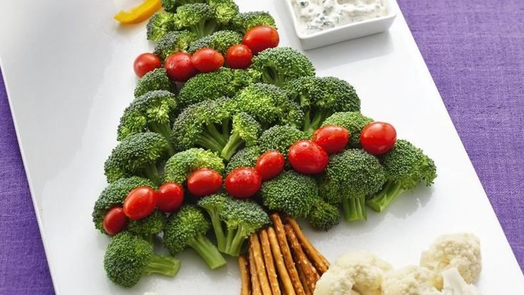 "A broccoli and tomato ""tree"" with pretzel ""trunk"" and cauliflower ""snow"" are delicious dippers for a cool and creamy dip."
