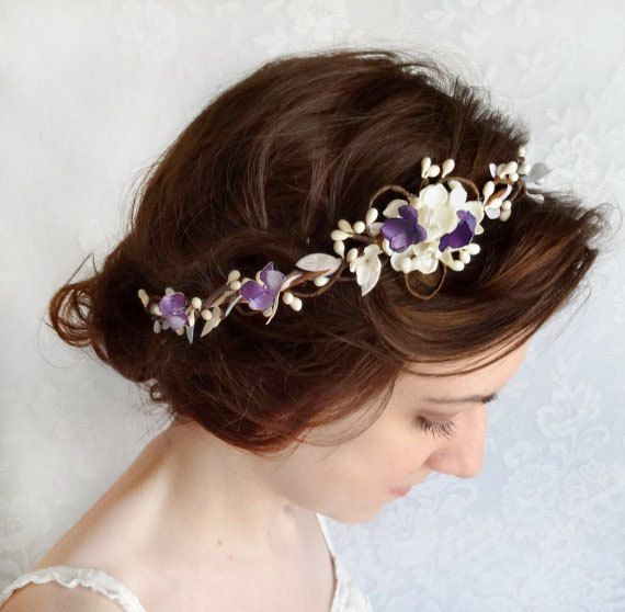 A beautiful hair vine adorned with leafy trim and jasmine blossoms. Choose between true white or ivory, with lilac/ light purple accents. Choose
