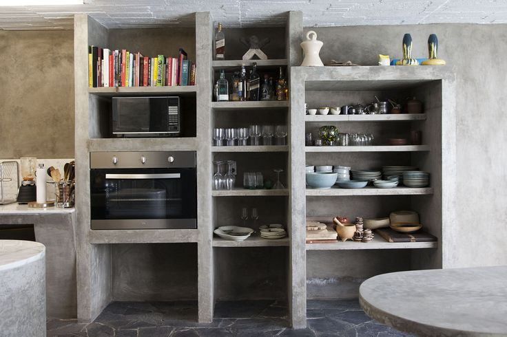 The concrete kitchen in Pedro Reyes and Carla Fernandez's Brutalist house in Mexico City via FvF | Remodelista
