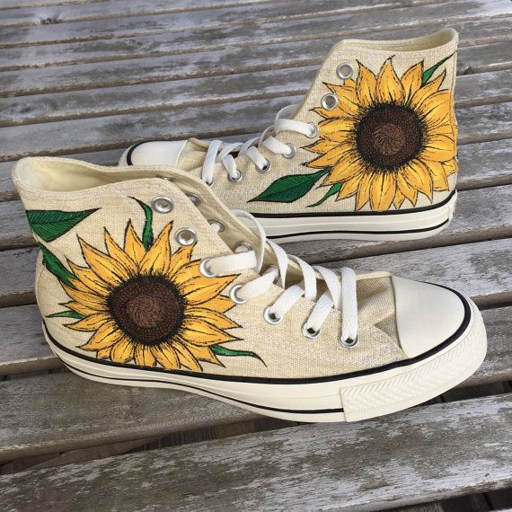 These are hi-top Converse sneakers with hand-drawn Sunflowers! Drawn completely free-handed, this design looks best on light-colored Converse sneakers (or other canvas shoes); the ones pictured are natural canvas. If you are interested in a color other than natural canvas please let me know. In addition, I am open to using other canvas shoes, such as lace-ups, Vans, Keds, Toms, etc.  Also, if you would like anything added to the design feel free to make them as personal as you would like! I…