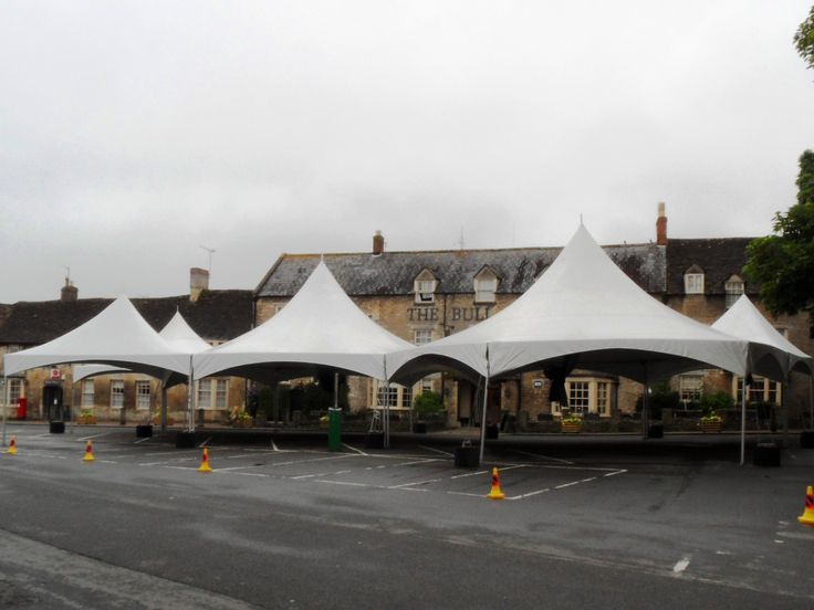 Bare bones canopies at the start of the Fairford Town Ball build, the Bull Hotel is in the background.This is two hexagonals, two squares and a triangle. June 2014.