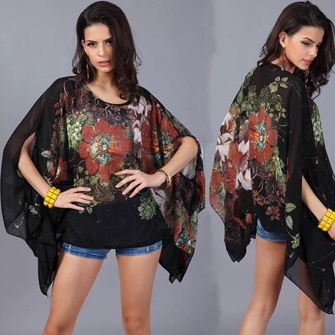 Black Chiffon Floral Tunic.  Wear to an evening out or to the pool.  This soft chiffon tunic is flowing and so romantic.  6 fun colors to choose from: Violet, Blue, Yellow, Watermelon, Black and White.  Each tunic has it's own floral design, you could have one of each - for every mood!