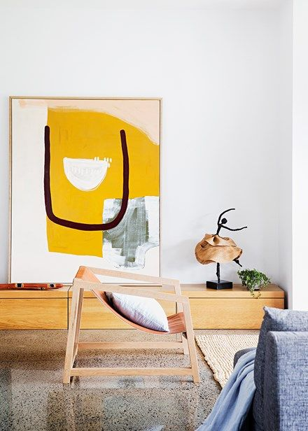 Local artists and artisans are featured throughout the home. This stunning artwork, A Portrait of a Young Girl by Jordan Henry, was found at The Plant Room in Manly | Home Beautiful Magazine Australia
