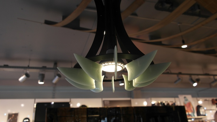 A small lamp made of surf fins.