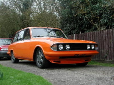 Had a Triumph 2000 Mk2 but pastel yellow with wheel spats