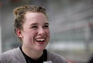 In this Thursday, June 6, 2013 photo, Taylor Crosby, younger sister of NHL hockey superstar Sidney Crosby, laughs during an interview in Calgary, Alberta. Crosby says she didn't choose goaltending to avoid comparisons with her famous brother Sidney. The 17-year-old from Cole Harbour, Nova Scotia, was one of 15 female goaltending prospects Hockey Canada invited to a five-day camp that opened Thursday. (AP Photo/The Canadian Press, Jeff McIntosh)