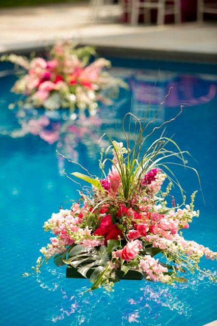 Just one bouquet in the middle of the pool might be really nice.  We'll have to anchor it with the shallow-end line.