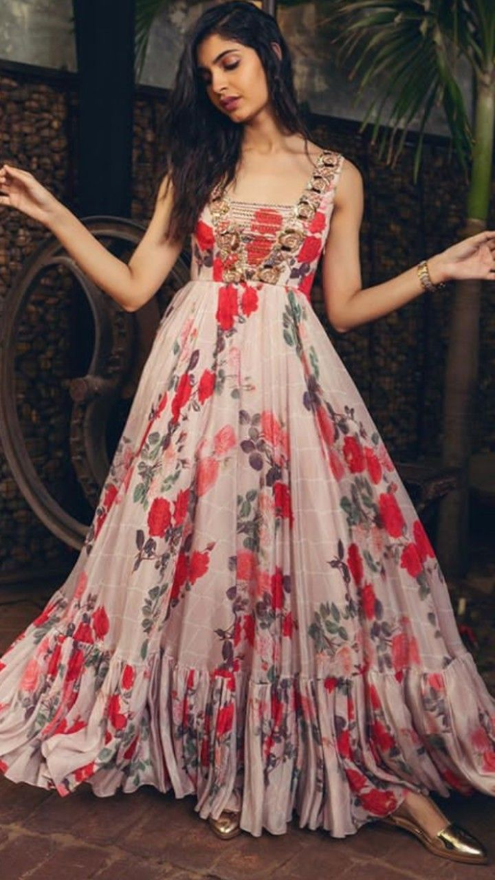 21b778194e46 Beautiful floral printed Silk Long Gown. Embellished with hand embroidery  on yoke. Light weight Gown is easy to wear in evening parties and occasions.