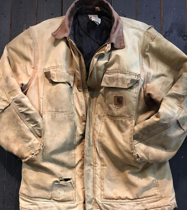 """""""One of our biggest Carhartt fans gave his coat back to us after he retired. This Sandstone Traditional Coat has been worn during every hard working day for 15 years long. It now has a unique place on the wall at our European Headoffice."""""""