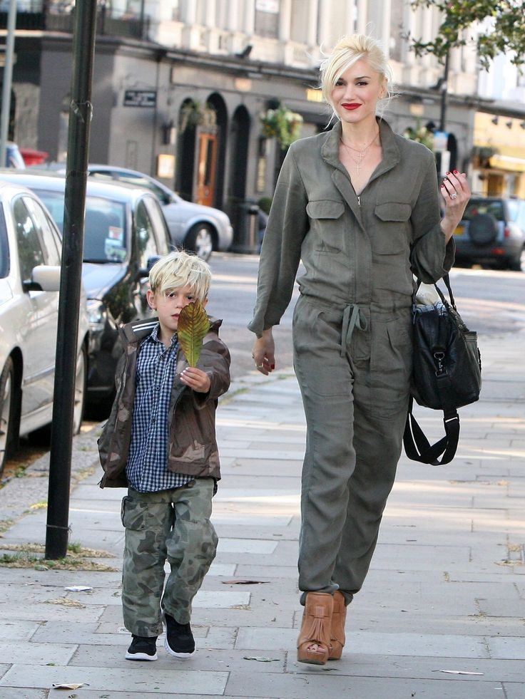 Gwen Stefani's jumpsuit is the perfect compliment to her son's camo pants.