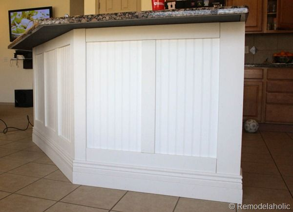 Pin by remodelaholic com on moldings and doors pinterest for Board and batten kitchen cabinets