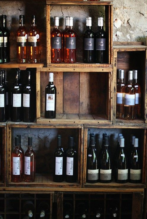 Wine crates as shelves - rustic yet sophisticated.