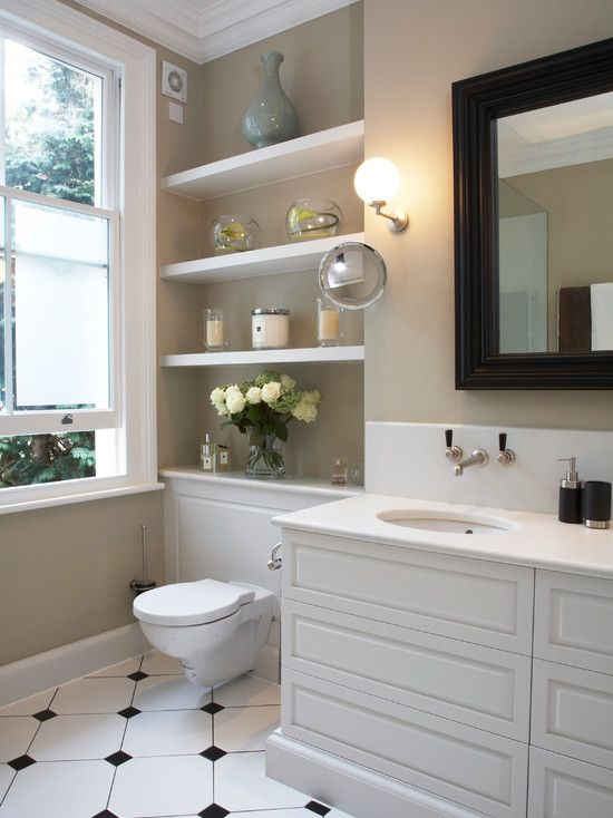 Great idea to make wall behind toilet attractive and soften hard surfaces of room