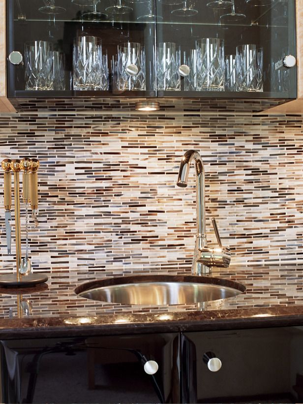Bar Backsplash Ideas Part - 41: The Cabinets In This Contemporary Wet Bar Are A Combination Of High-gloss  Cherry Wood And High-gloss Black. The Glass Tile Backsplash And Custom-made  Glass ...