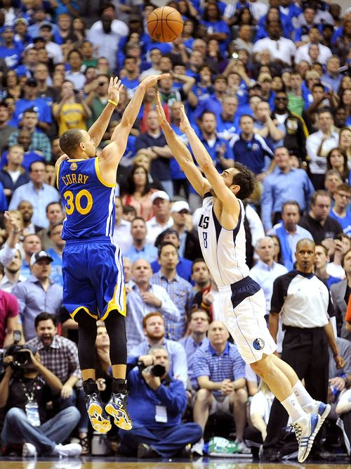 Golden State Warriors guard Stephen Curry (30) shoots the game-winning shot over Dallas Mavericks guard Monta Ellis (11) in overtime during a NBA basketball game, Tuesday, April 1, 2014, in Dallas. Golden State won 122-120. (AP Photo/Matt Strasen)