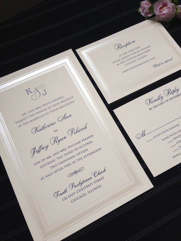 Classic Navy and Pearl wedding invitation. Pearlized foil border..