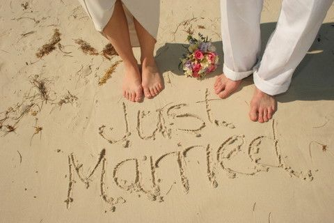 This is a cute idea. I have also seen a picture with the bride and groom's hand prints in the sand with the actual rings on the sand fingers.