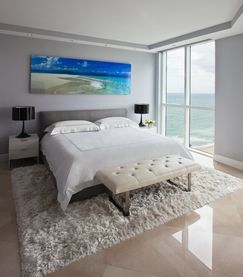 High rise condo on the beach for NY based executive.  Clean, cool and comfortable to accommodate South Florida living.