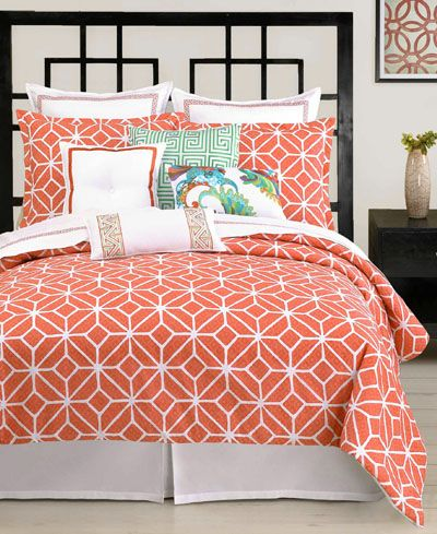 Teal and coral bedspread.