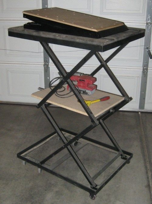 """Workshop Lift Table by MetalDesigner -- I made this Small Workshop Lift-Table a few years ago and use it almost daily. The table is raised and lowered by using a 1/2 horse drill with a socket attachment to turn a nut welded to the end of an ACME threaded rod that goes through another ACME Nut. As many of you know, ACME thread is considered a 'Trapezoidal Thread Form"""" used for simple Leadscrews because the thread's tooth shape wears better and allows it to carry a greater..."""