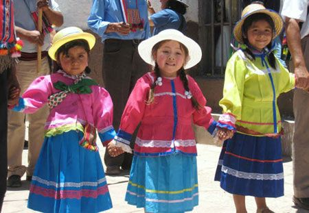 Chilean girls in their beautifully bright coloured traditional garb, fantastic!