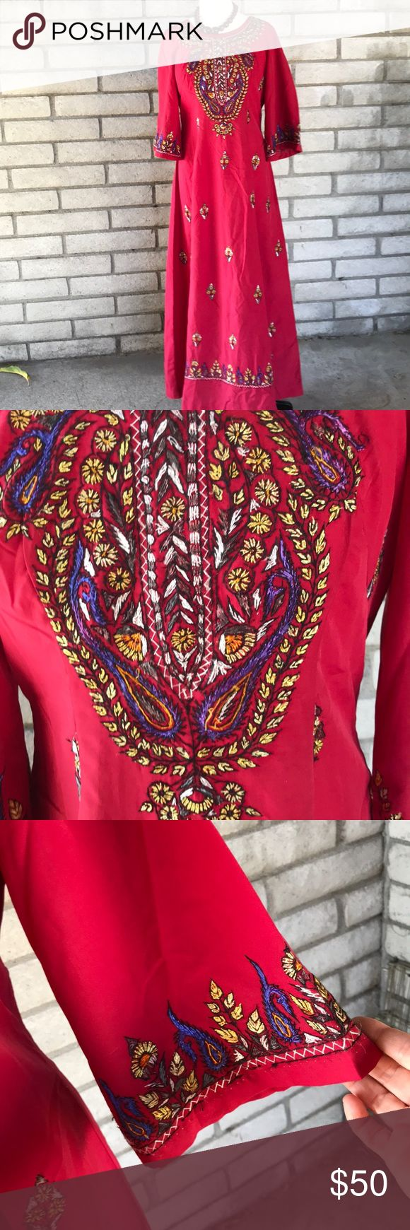 """Vintage Tribal Maxi Gorgeous embroidered bell sleeves maxi. Purple yellow, saffron, black, white threads on scarlet red.  White metal zip+ hook  up the back. A few signs of wear, small spots as noted in pics. No tags maybe rayon? Chest is 19"""" flat no stretch Length is 57.5"""". Bitchin  festival dress m to l Dresses Maxi"""