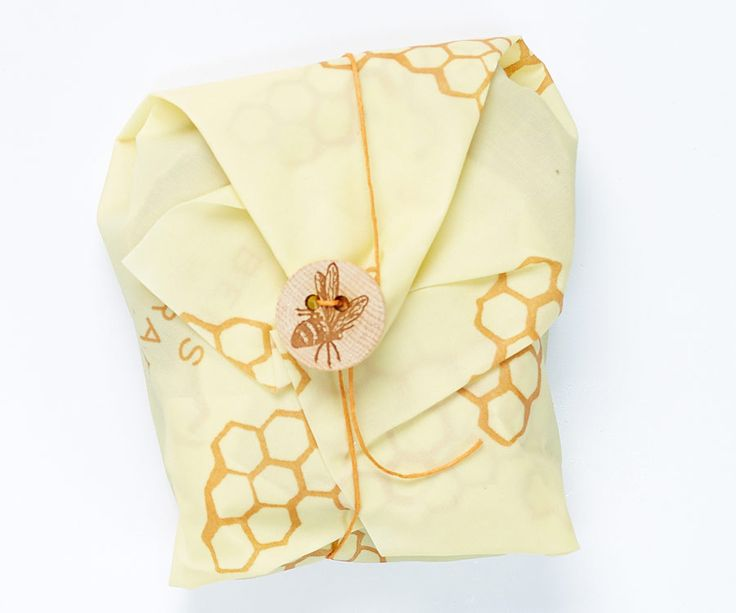 The Hive Box - Reusable, beeswax-coated food wrap for earth friendly food storage! This sandwich wrap comes with a sweet wooden bee button to wrap your sandwich up safely.