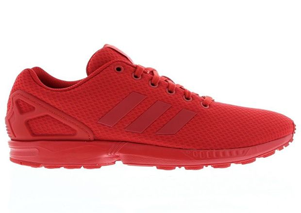 all red adidas trainers