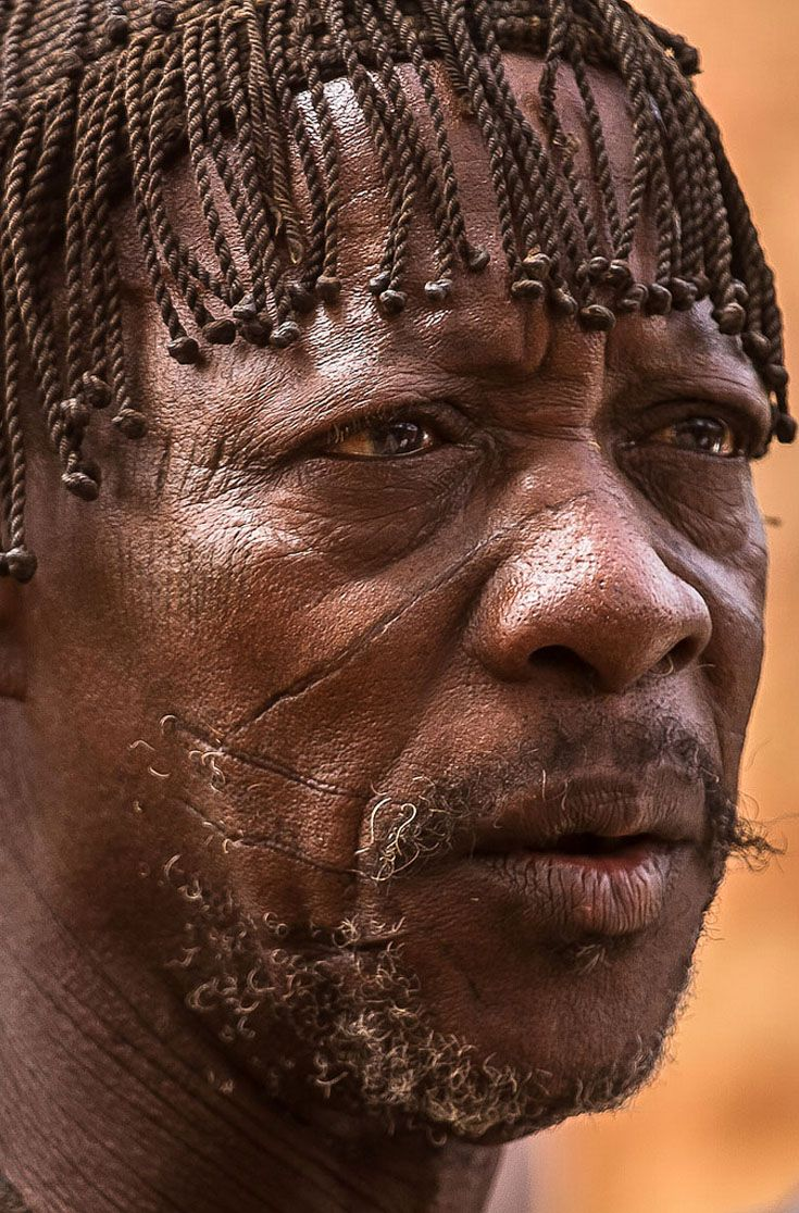 Africa | Mossi man with traditional scarification.  Burkina Faso | ©Anthony Pappone