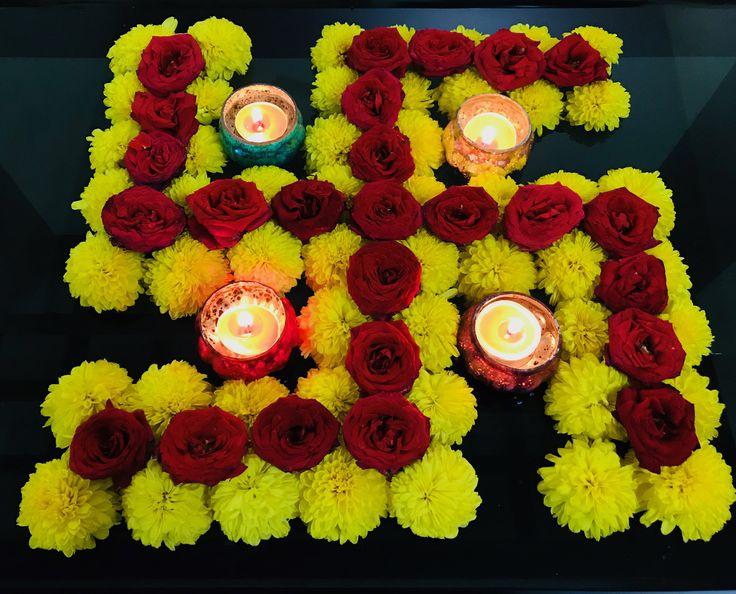 Innovative Swastik flower arrangement for Diwali festival.
