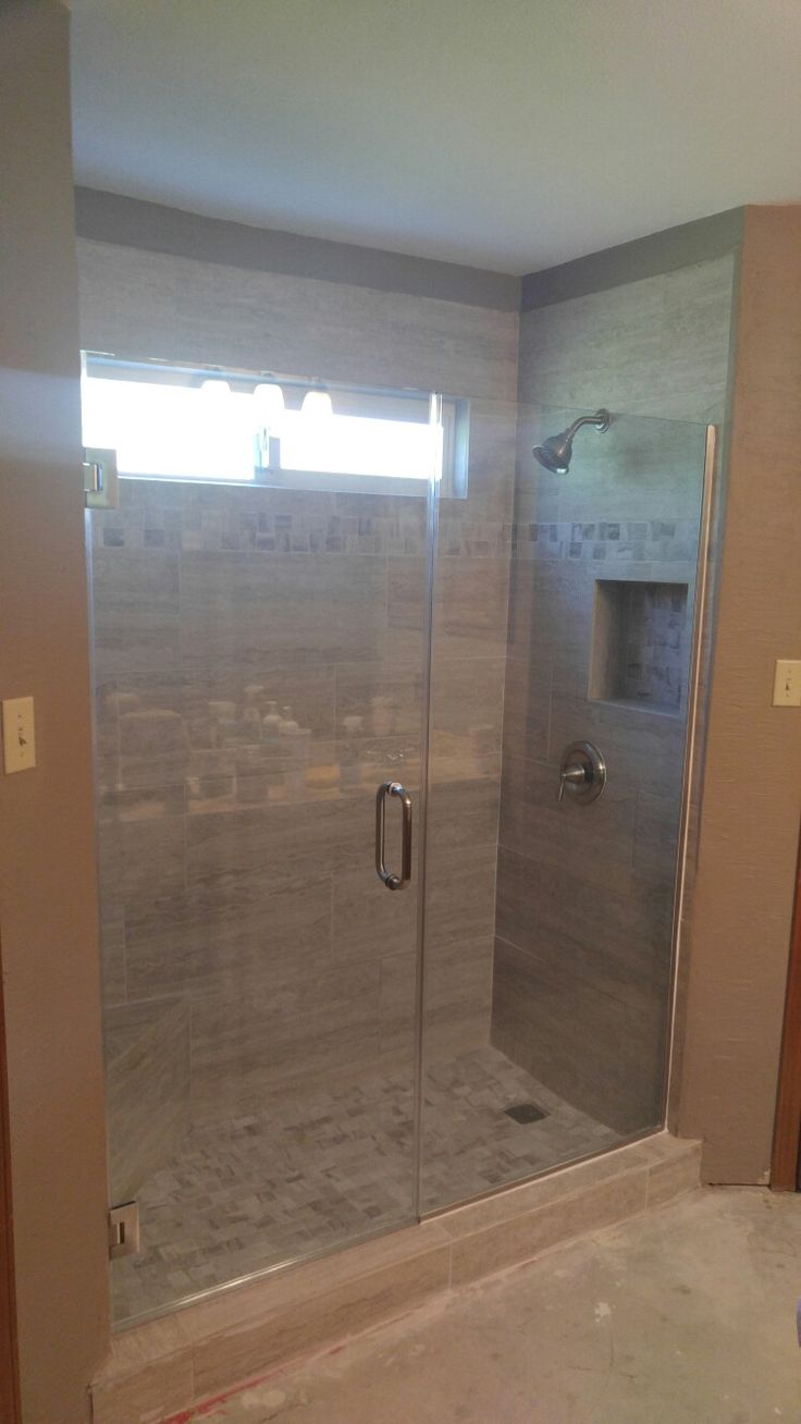 This was a tub shower that we made into a walk in shower for How wide is a bathtub