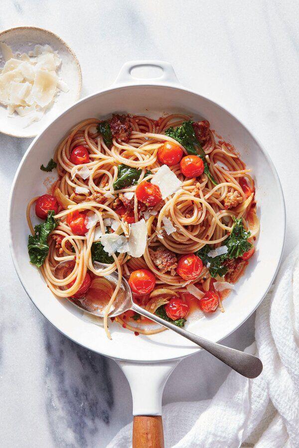 garlicky kale sausage and tomato pasta recipe in 2020 flavorful recipes garlicky kale tomato pasta pinterest