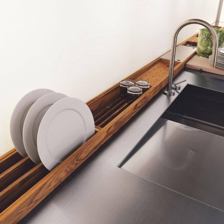 Mounted drying racks on wall behind sink