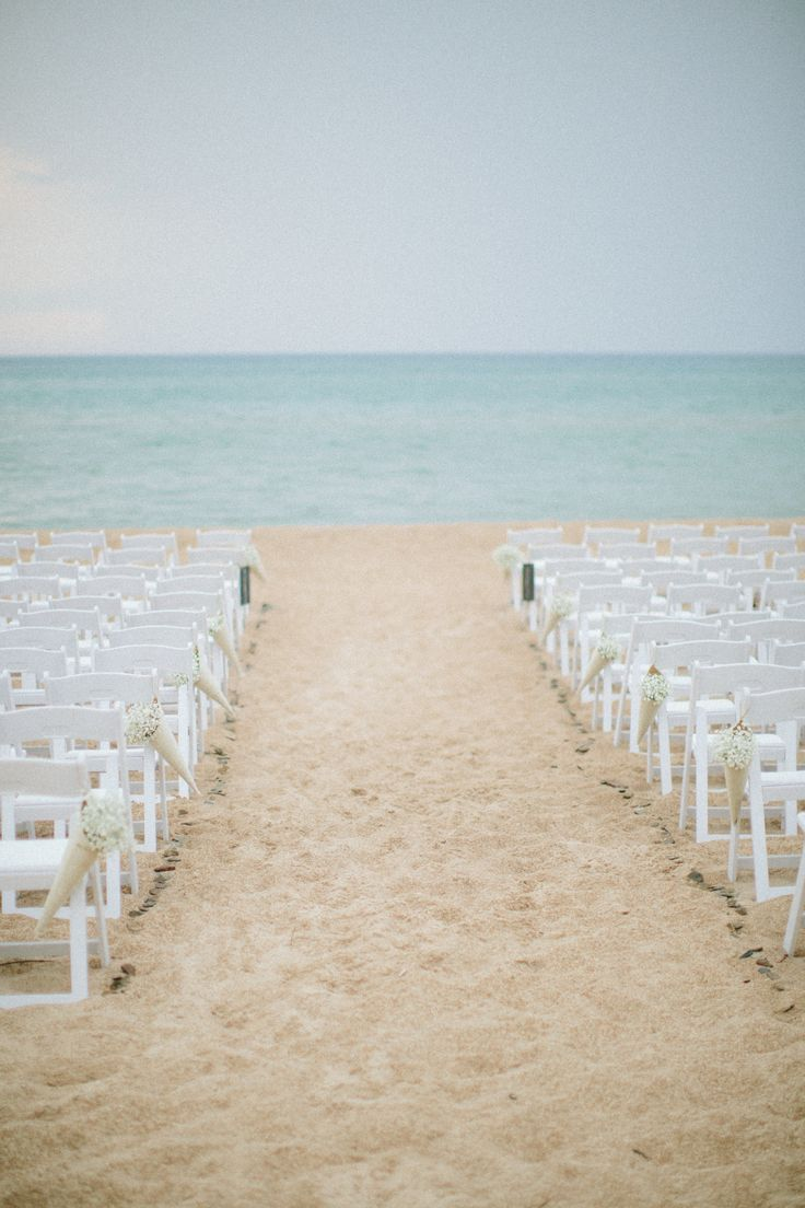 Lake Michigan ceremony. Photography: J.Cole Photography - JacquiCole.com  Read More: http://www.stylemepretty.com/little-black-book-blog/2014/02/04/beachside-lake-michigan-wedding-at-home/