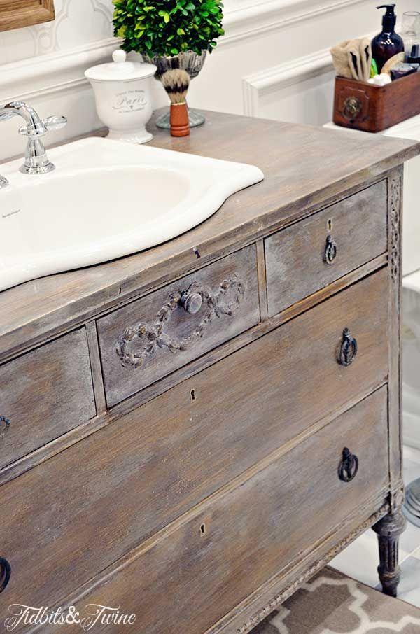 TIDBITS-&-TWINE-Guest-Bathroom-Dresser-Vanity - curved edges of sink look great against the wod