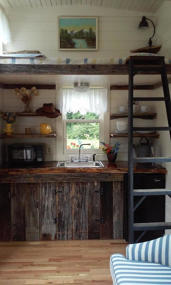 Brilliant tiny sleeping loft, doesn't feel claustrophobic, doesn't make the space feel smaller, looks cozy (although I'd have to add at least a tiny railing for fear of rolling off).