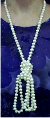 Rope Pearl Necklace- I have one just like this, and never knew there were so many ways to wear it!