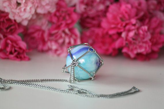 Geometric necklace with blue marbles in a metal by DeaJewelryStore