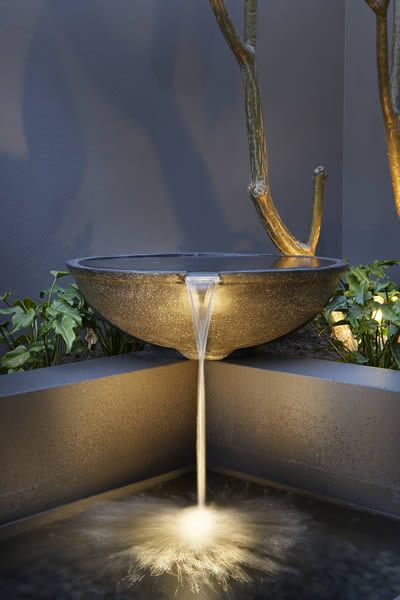 A contemporary water feature showing what a difference good lighting can make.  This one by The Garden Light Company.