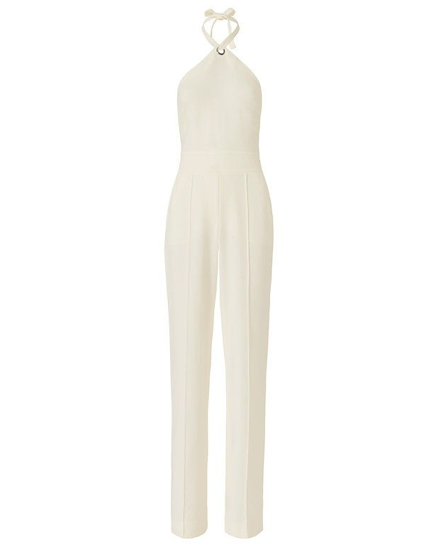A.L.C. Corinna Halter Ring Jumper: A halter neckline self ties through a silver-tone ring detail. Open back with zip at lower. Tonal topstitched waistline. Faux fly. Two slant frontal pockets and two flap pockets at rear. Wide leg silhouette. Lined. In white. Fabric: 97% viscose/3% ...