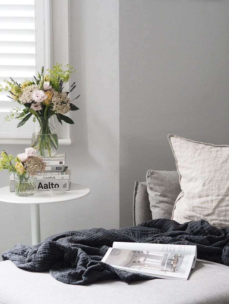 Simple grey interior with Spring flowers and soft tones. Styling Spring blooms with Bloom & Wild's letterbox flowers