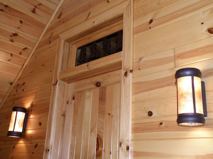 Imposing Interior Log Cabin Paneling With Solid Knotty
