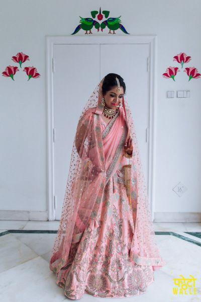 Bridal Lehenga - Radhika & Rahul   WedMeGood   Light Pink Lehenga with Silver Embroidery #wedmegood #indianbride #indianlehenga #weddinglehenga #lehenga #indianwedding #bridal #pink