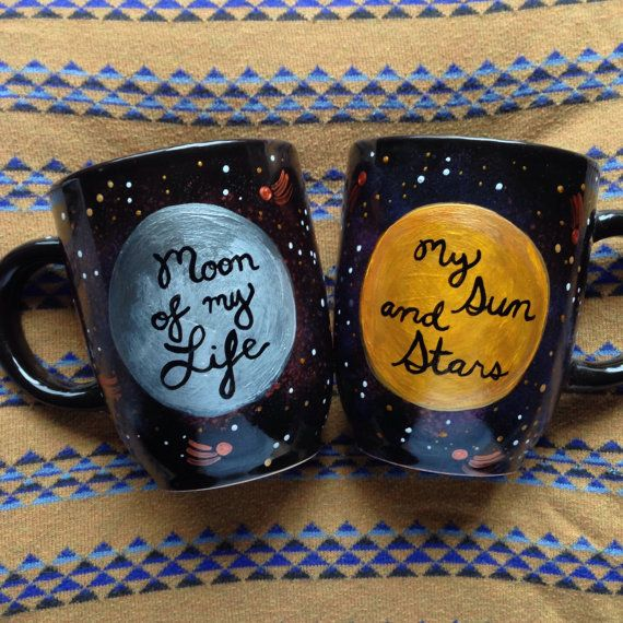 This pair of mugs is perfect for you and your honey. One reads my sun and stars, the other moon of my life. Even non-GOT fans (is there such a thing?) will recognize the sentiment behind these celestial themed love mugs. I hope you enjoy using them as much as I enjoyed painting them. Capacity: each mug holds 16oz Mug height: 4.5 Mug mouth opening: 3.25   Perfect for:    Valentines Day Birthday  Anniversary  Engagement  Husband  Wife  Boyfriend  Girlfriend  Best Friend  Game of Thrones…