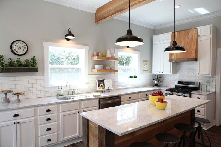 love the carrera marble, white cabinets, rustic board island, beams, even the the range hood is so cool!