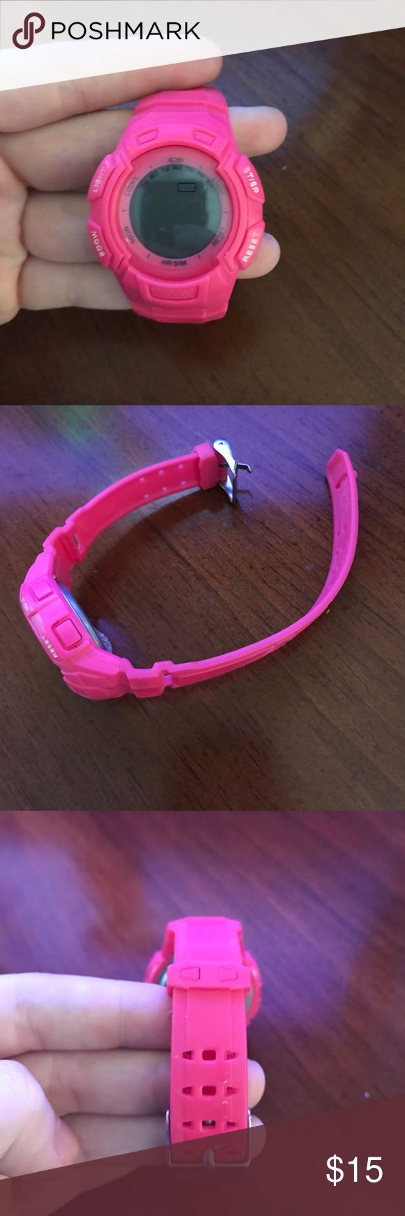 ⭕️FINAL SALE⭕️Pink Champion Watch EUC. Does need a new battery (takes a lithium battery)! Has many features including, a stopwatch, date, water proof, and setting alarms. Plastic band! Adjustable to fit about any wrist size. If you have any questions or need additional pictures, please let me know! 🤗 Champion Accessories Watches