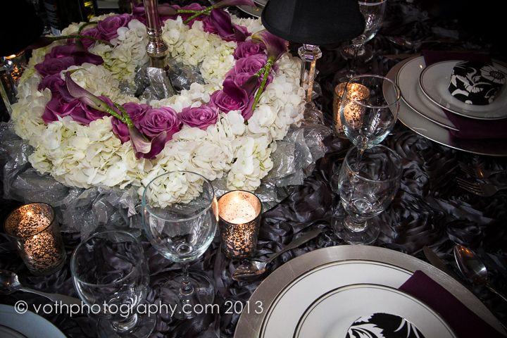 Unique wedding centrepiece at the base of a candelabra.